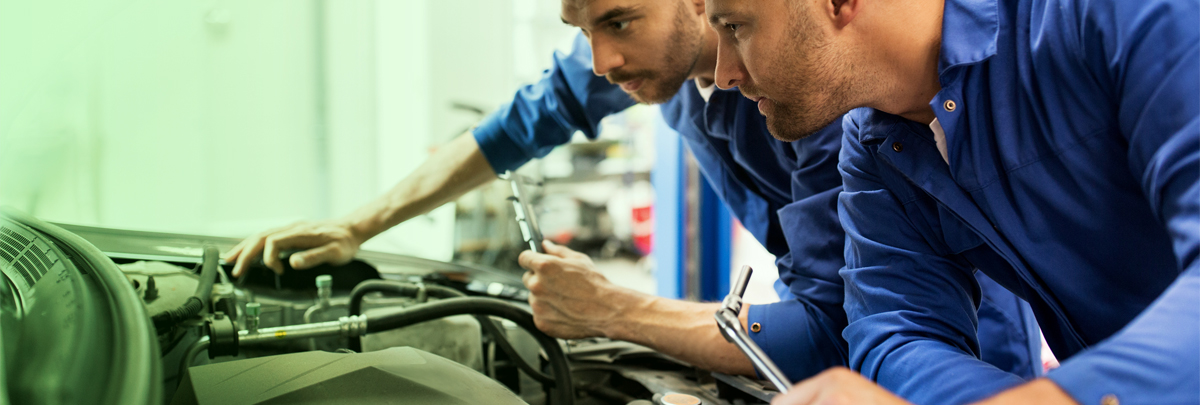 Technicians servicing a vehicle - Car Servicing Mitcham