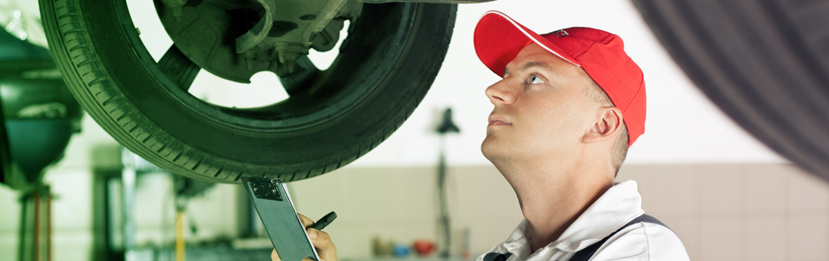 Mechanic carrying out an MOT Test - MOT Mitcham